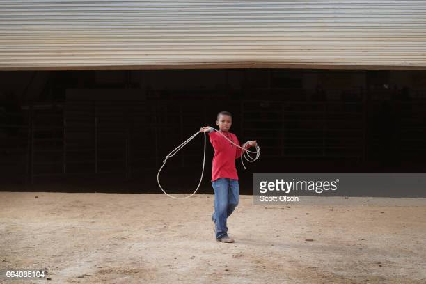 Ronald Jennings practices with a rope before the start of competition at the Bill Pickett Invitational Rodeo on March 31 2017 in Memphis Tennessee...