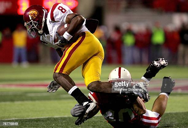Ronald Johnson of the USC Trojans is brought down by Lance Brandenburgh of the Nebraska Cornhuskers on September 15 2007 at Memorial Stadium in...