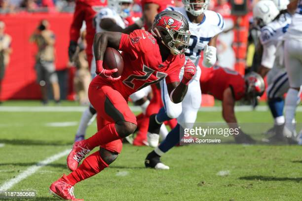 Ronald Jones II of the Bucs carries the ball during the regular season game between the Indianapolis Colts and the Tampa Bay Buccaneers on December...
