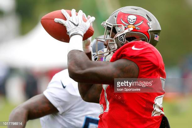 Ronald Jones II of the Bucs catches a pass during the joint training camp work out between the Tampa Bay Buccaneers and the Tennessee Titans on...
