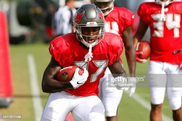 Ronald Jones II of the Bucs goes thru a drill during the joint training camp work out between the Tampa Bay Buccaneers and the Tennessee Titans on...