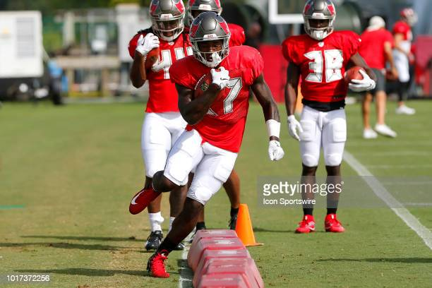 Ronald Jones II of the Bucs shows his hip flexibility as he goes thru a drill during the joint training camp work out between the Tampa Bay...