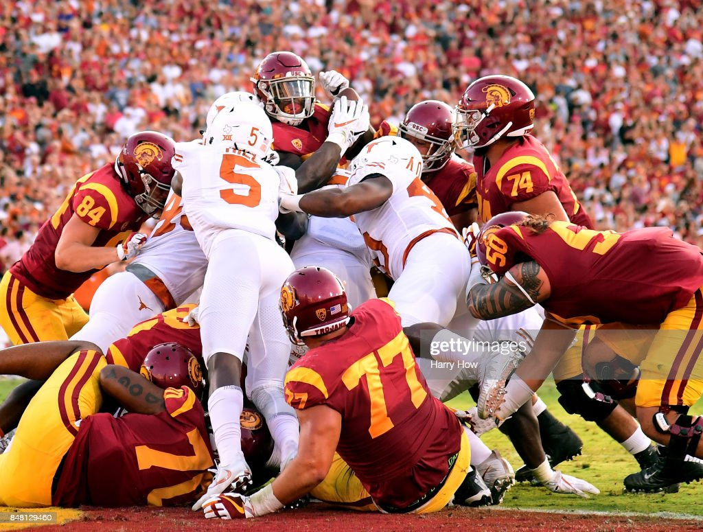 Ronald Jones II #25 of the USC Trojans is stopped by the Texas Longhorns defense at the goal line during the first quarter at Los Angeles Memorial Coliseum on September 16, 2017 in Los Angeles, California.