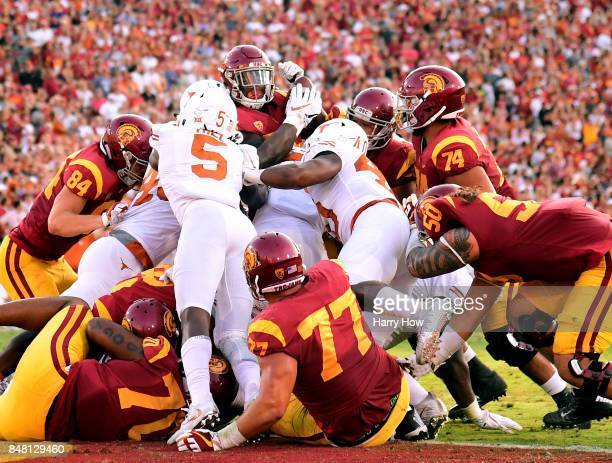 Ronald Jones II of the USC Trojans is stopped by the Texas Longhorns defense at the goal line during the first quarter at Los Angeles Memorial...
