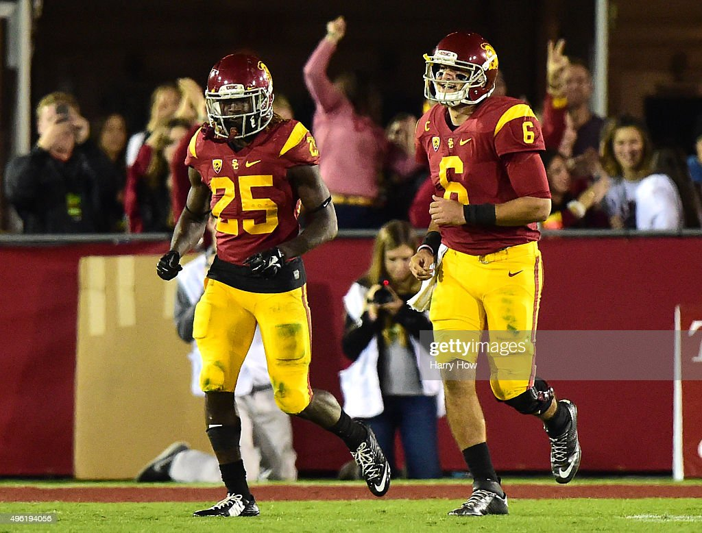 Ronald Jones II #25 of the USC Trojans reacts to his 74 yard touchdown run with Cody Kessler #6 during the fourth quarter at Los Angeles Coliseum on November 7, 2015 in Los Angeles, California.