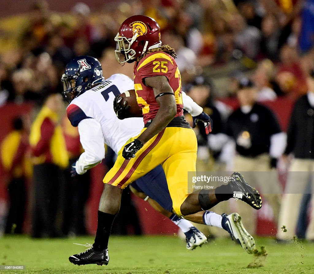Ronald Jones II #25 of the USC Trojans runs 74 yards for a touchdown past Marquis Ware #2 of the Arizona Wildcats during the fourth quarter at Los Angeles Coliseum on November 7, 2015 in Los Angeles, California.