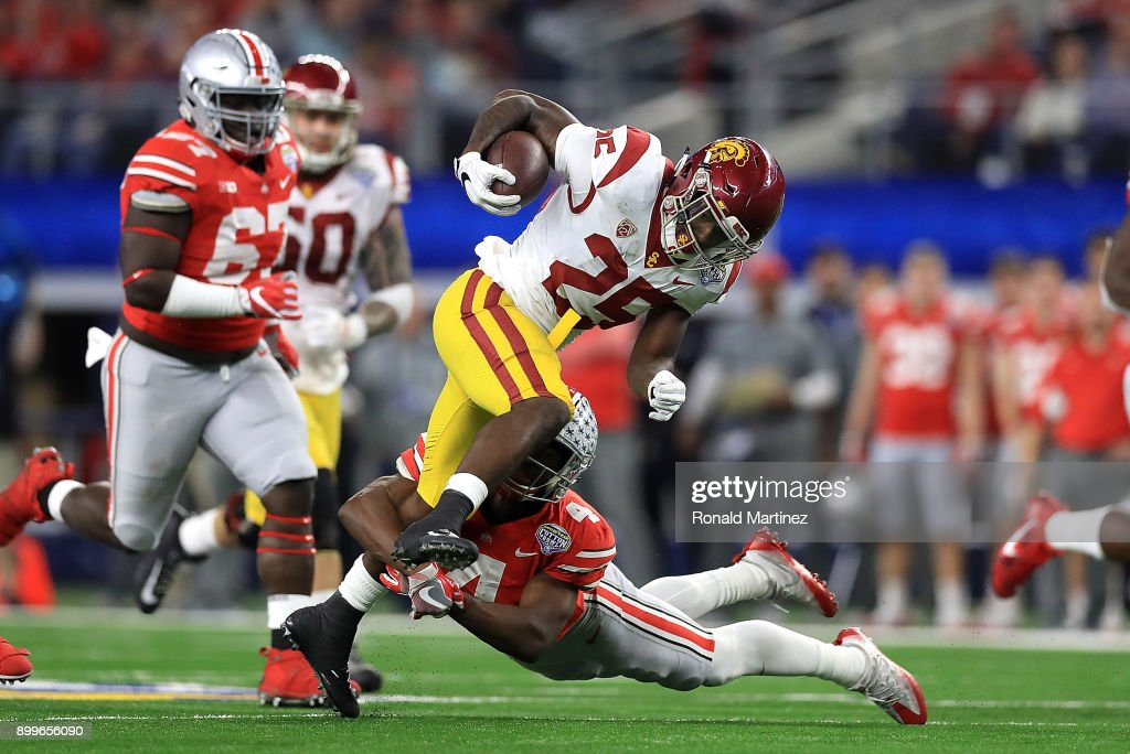 Ronald Jones II #25 of the USC Trojans runs the ball against Jordan Fuller #4 of the Ohio State Buckeyes in the third quarter during the Goodyear Cotton Bowl at AT&T Stadium on December 29, 2017 in Arlington, Texas.