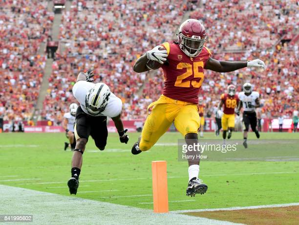 Ronald Jones II of the USC Trojans scores a touchdown past Sam Beal of the Western Michigan Broncos to take a 3528 lead during the fourth quarter at...