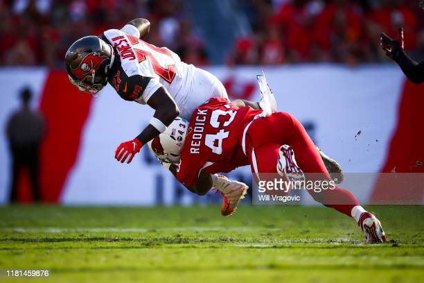 Ronald Jones of the Tampa Bay Buccaneers brought down on a run by Haason Reddick of the Arizona Cardinals during the game on November 10 2019 at...