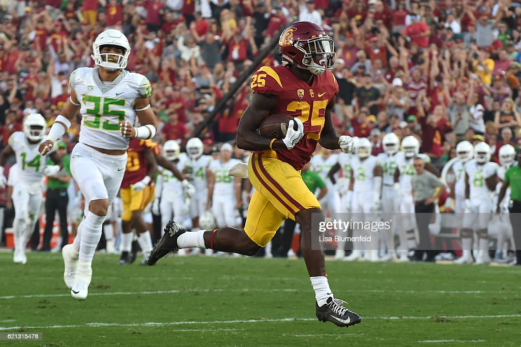Ronald Jones #25 of the USC Trojans carries the ball to score a touchdown in the first quarter against the Oregon Ducks at Los Angeles Memorial Coliseum on November 5, 2016 in Los Angeles, California.