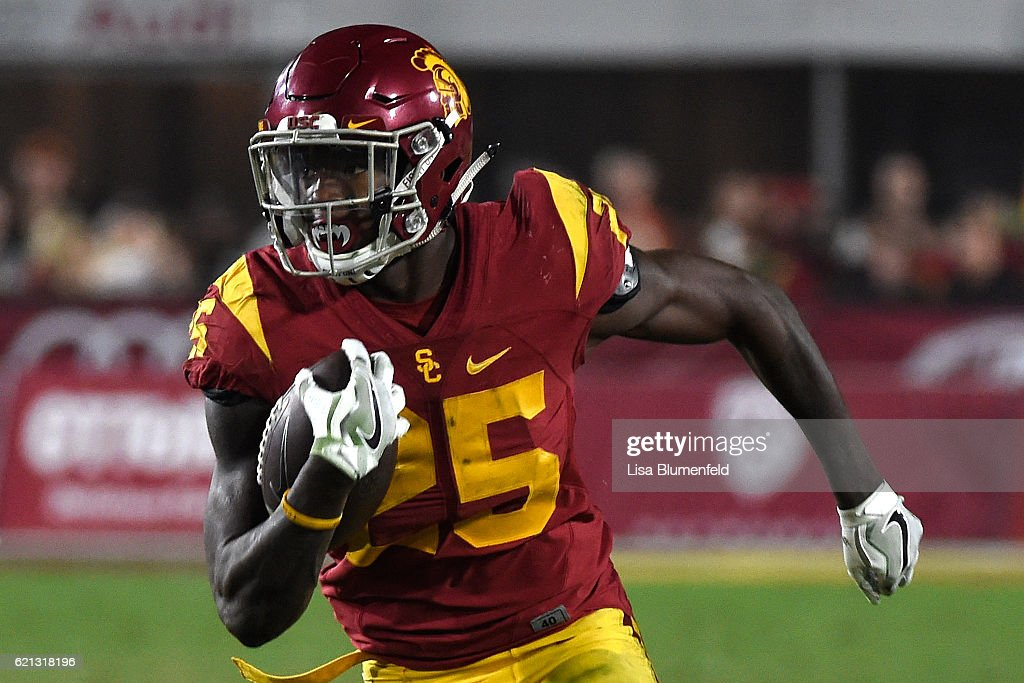 Ronald Jones #25 of the USC Trojans carries the ball to score a touchdown in the fourth quarter against the Oregon Ducks at Los Angeles Memorial Coliseum on November 5, 2016 in Los Angeles, California.