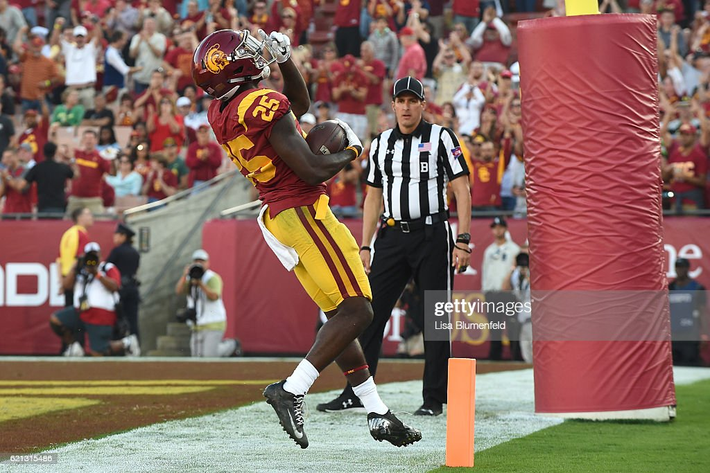 Ronald Jones #25 of the USC Trojans celebrates scoring a touchdown in the first quarter against the Oregon Ducks at Los Angeles Memorial Coliseum on November 5, 2016 in Los Angeles, California.