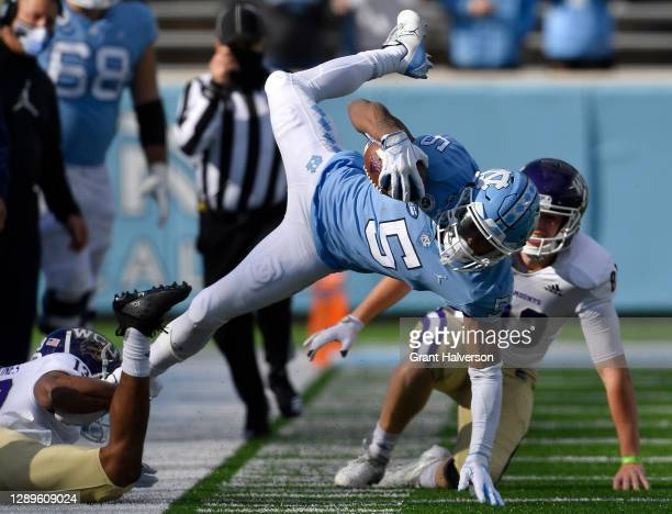 Ronald Kent of the Western Carolina Catamounts tackles Dazz Newsome of the North Carolina Tar Heels during their game at Kenan Stadium on December...