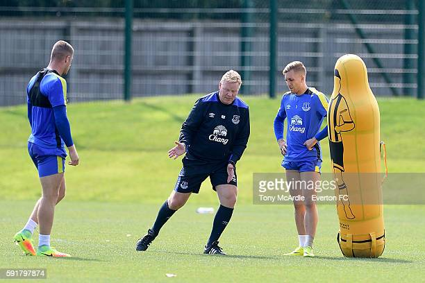 Ronald Koeman coaching Ross Barkley and Gerard Deulofeu during the Everton FC training session at Finch Farm on August 18 2016 in Halewood England