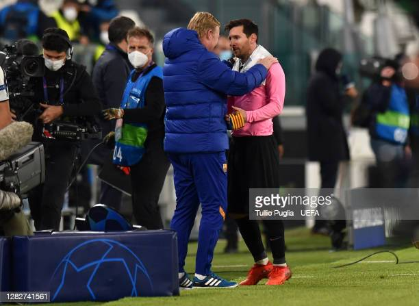 Ronald Koeman Head Coach of Barcelona and Lionel Messi of Barcelona speak during the UEFA Champions League Group G stage match between Juventus and...
