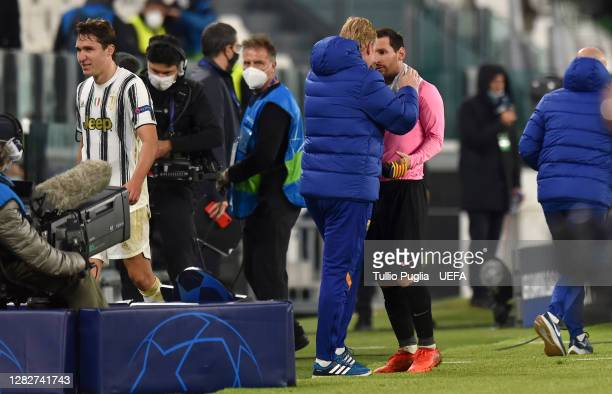 Ronald Koeman Head Coach of Barcelona talks to Lionel Messi after the UEFA Champions League Group G stage match between Juventus and FC Barcelona at...