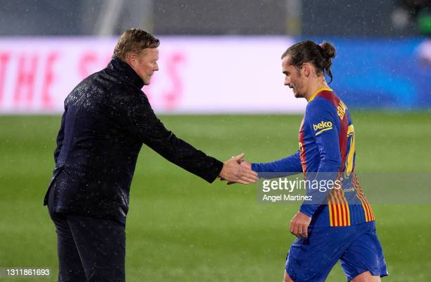 Ronald Koeman, Head Coach of FC Barcelona interacts with Antoine Griezmann of FC Barcelona after the La Liga Santander match between Real Madrid and...