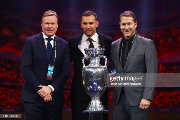 Ronald Koeman Head coach of the Netherlands Andriy Shevchenko Head Coach of Ukraine and Franco Foda Head Coach of Austria pose for a photo with The...