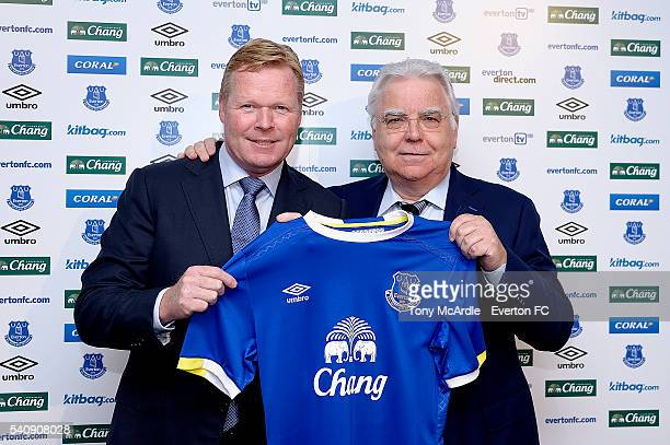 Ronald Koeman holds up a shirt with Chairman Bill Kenwright during his first press conference as Everton manager at Finch Farm on June 17 2016 in...