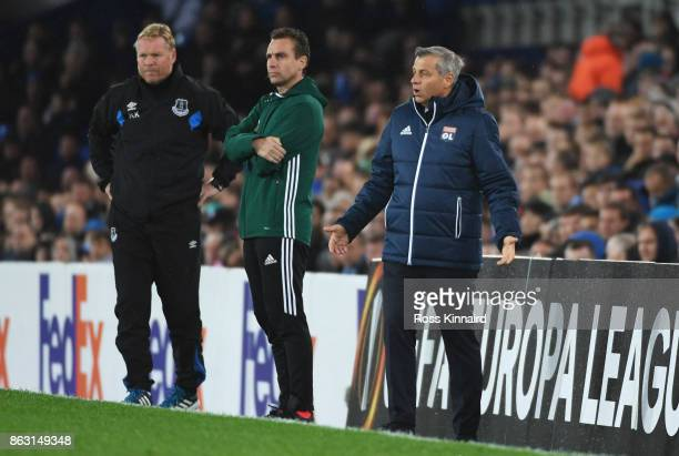 Ronald Koeman Manager of Everton and Bruno Genesio manager of Lyon look on from the touchline during the UEFA Europa League Group E match between...