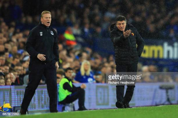 Ronald Koeman Manager of Everton and Walter Mazzarri Manager of Watford both give their sides instructions during the Premier League match between...