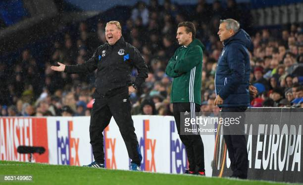 Ronald Koeman Manager of Everton reacts as Bruno Genesio manager of Lyon looks on from the touchline during the UEFA Europa League Group E match...