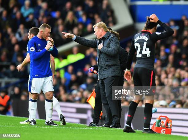 Ronald Koeman Manager of Everton speaks to Wayne Rooney of Everton during the Premier League match between Everton and Arsenal at Goodison Park on...
