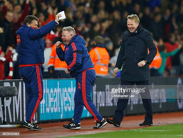 Ronald Koeman manager of Southampton celebrates with coaches Erwin Koeman and Sammy Lee as Shane Long of Southampton scores their fourth goal during...