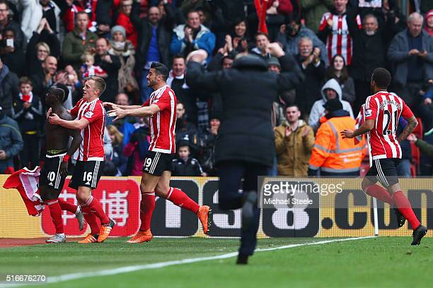 Ronald Koeman manager of Southampton runs along the touchline as Sadio Mane of Southampton celebrates wtih team mates as he scores their third goal...