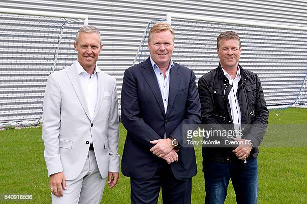 Ronald Koeman poses for a photo with colleagues Jan Kluitenberg and Erwin Koeman before his first press conference as Everton manager Finch Farm on...