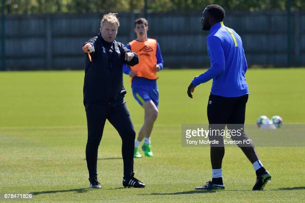 Ronald Koeman speaks to Romelu Lukaku during the Everton FC training session at USM Finch Farm on May 4 2017 in Halewood England