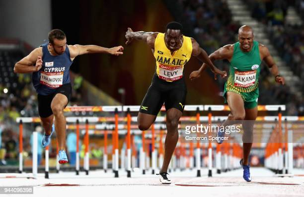 Ronald Levy of Jamaica crosses the line to win gold ahead of Antonio Alkana of South Africa and Milan Trajkovic of Cyprus in the Men's 110 hurdles...