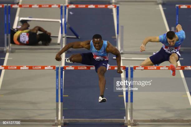 Ronald Levy of Jamaica on his way to victory in the men's 60m hurdles final from Andrew Pozzi of Great Britain as Jarret Eaton of USA falls during...