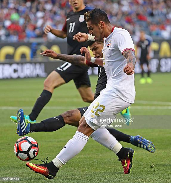 Ronald Matarrita of Costa Rica is pressured by DeAndre Yedlin of United States during a match in the 2016 Copa America Centenario at Soldier Field on...