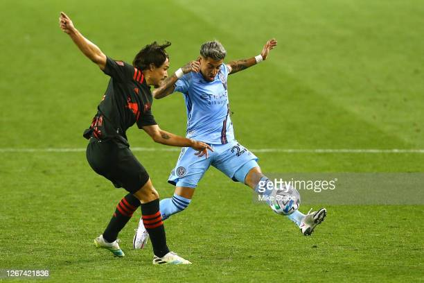Ronald Matarrita of New York City and Florian Valot of New York Red Bulls vie for the ball at Red Bull Arena on August 20, 2020 in Harrison, New...