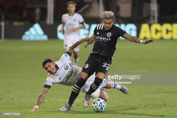 Ronald Matarrita of New York City controls the ball past Marvin Loria of Portland Timbers during a quarter final match of MLS Is Back Tournament...