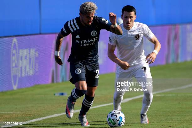 Ronald Matarrita of New York City FC and Lewis Morgan of Inter Miami CF fight for the ball during the first half in the MLS is Back Tournament at...
