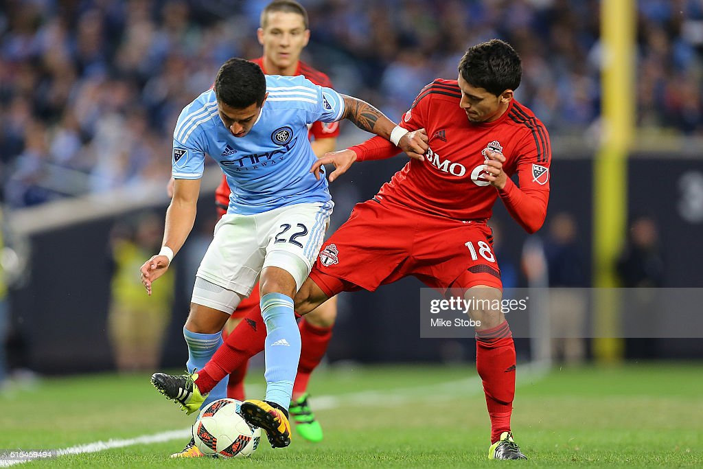 Ronald Matarrita #22 of New York City FC and Marco Delgado #18 of Toronto FC vie for the ball at Yankee Stadium on March 13, 2016 in the Bronx borough of New York City.