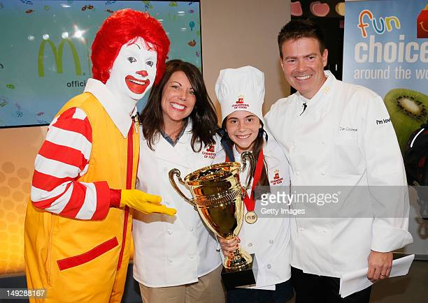 Ronald McDonald and Executive Chef Dan Coudreaut award the winning Champions of Food team Sarah Ralston and mother Theresa Ralston of New Albany Ohio...