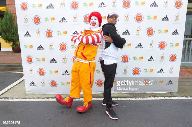 Ronald McDonald and Host RockT attends 'McDonald's All American Games Fan Fest' at Atlantic Station on March 25 2018 in Atlanta Georgia