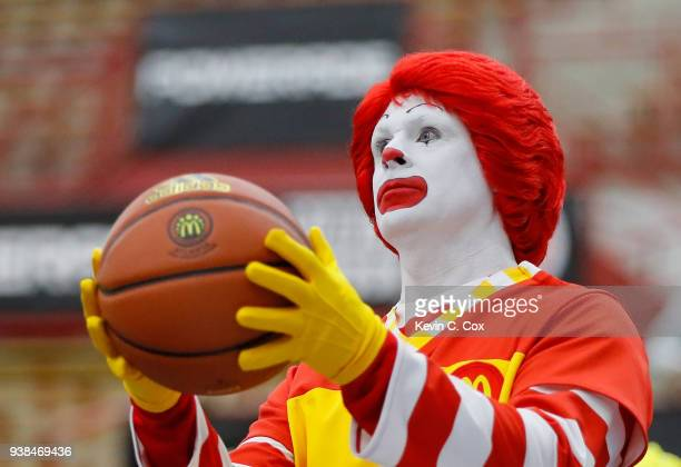 Ronald McDonald helps players warm up prior to the 2018 McDonald's All American Game POWERADE Jam Fest at Forbes Arena on March 26 2018 in Atlanta...