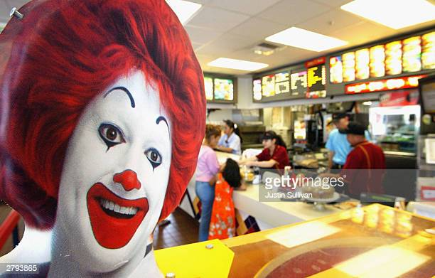 A Ronald McDonald sign overlooks the counter at a McDonald's restaurant July 29 2003 in Redwood City California McDonald's posted December 8 2003 its...