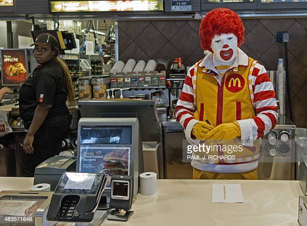 Ronald McDonald stands behind the counter during his appearance at a McDonalds's August 10 in Centreville Virginia AFP PHOTO/PAUL J RICHARDS
