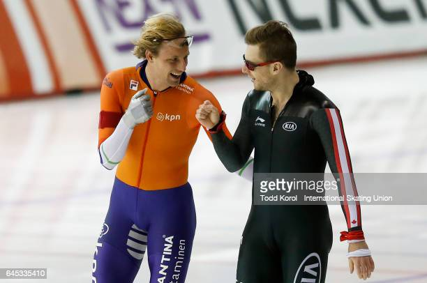 Ronald Mulder of the Netherlands and Laurent Dubreuil of Canada celebrate their men's 500 meter race during the ISU World Sprint Speed Skating...