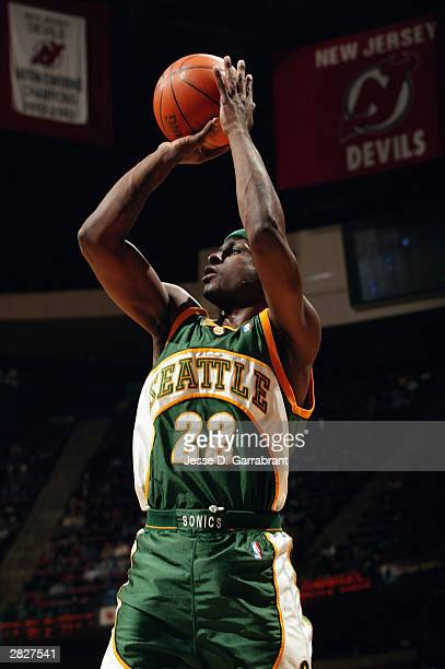 Ronald Murray of the Seattle Sonics shoots a jumper during the game against the New Jersey Nets at Continental Airlines Arena on December 9 2003 in...