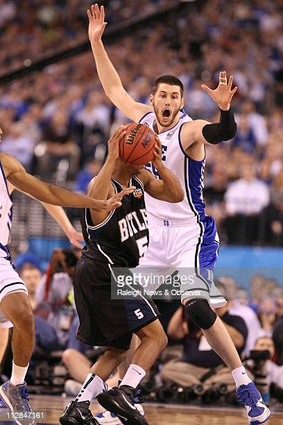 Ronald Nored of Butler looks for an open man as Brian Zoubek of Duke defends in the first half of the NCAA Final Four championship game at Lucas Oil...
