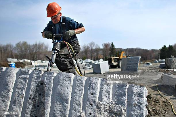 Ronald Percy works on a piece of granite near a Rock of Ages Corp quarry in Graniteville Vermont US on Tuesday April 22 2008 Rock of Ages Corp...