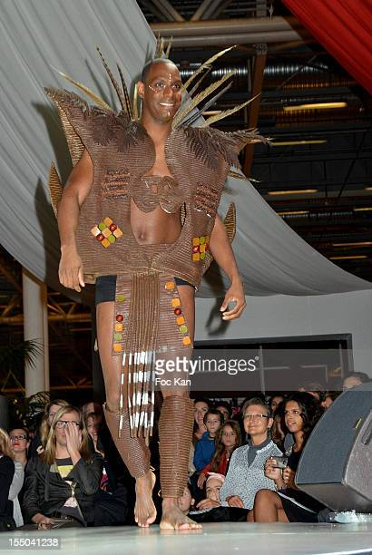 Ronald Pognon dressed by Lea Larcheveque and Patrice Chapon walks the runway during the Salon du Chocolat 2012 Opening Night at Parc des Expositions...