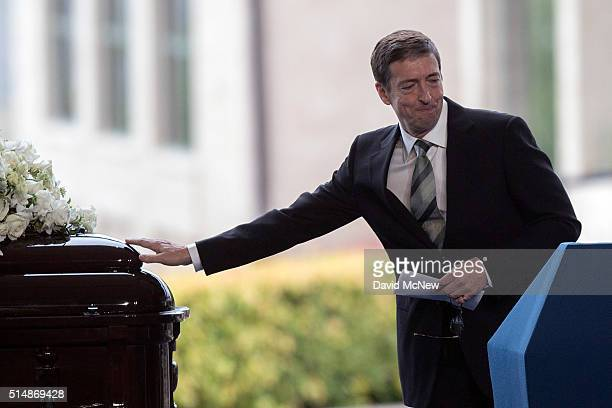 Ronald Prescott Reagan touches the casket of of his mother during funeral and burial services for former first lady Nancy Reagan at the Ronald Reagan...