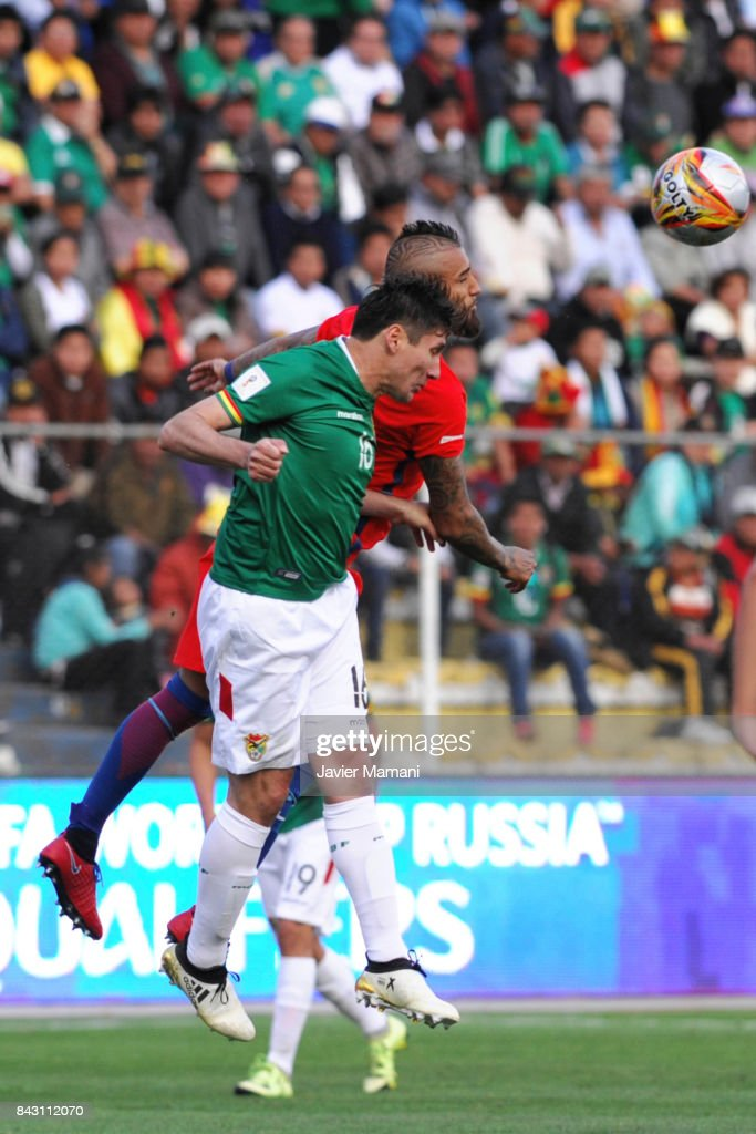 Ronald Raldes of Bolivia fights for the bal with Arturo Vidal of Chile during a match between Bolivia and Chile as part of FIFA 2018 World Cup Qualifiers at Hernando Siles Stadium on September 05, 2017 in La Paz, Bolivia.